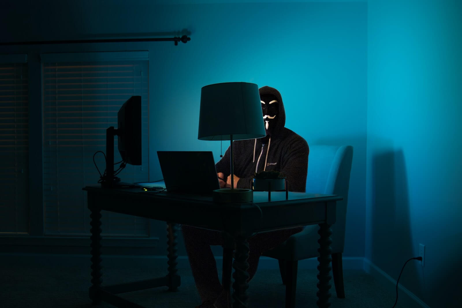 a man in a mask on a computer