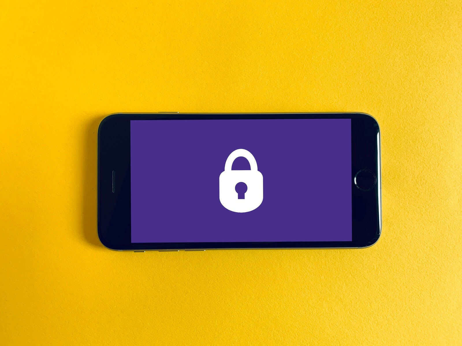 a yellow background with a purple cell phone